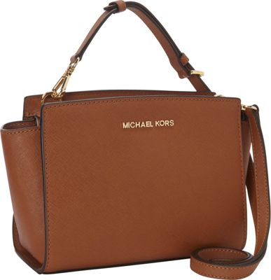 Highlights for Michael Kors. No doubt about it, every piece of clothing in your closet looks great with a classic Michael Kors handbag. It's a lesson in the magic of .